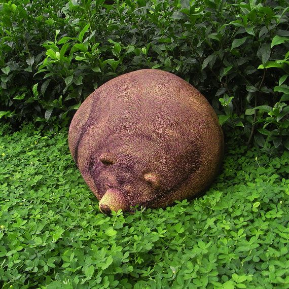 Beanbag chairs are great but you know what is better than a plain old boring beanbag chair? A Sleeping Grizzley bear beanbag chair.