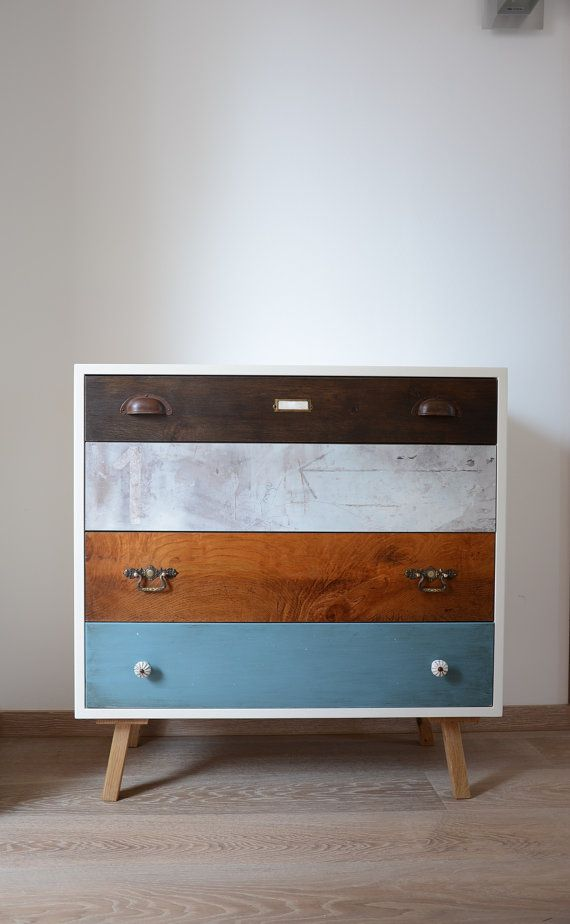 This modern vintage dresser in vintage style was compiled from four different drawers . Here is a colorful mix of oak , a coated laminated board , antique ash veneer of a side wall and a drawer front in MDF painted laminate . The feet are also made oak for this piece . The drawers are all equipped with modern drawer slides open and easily without scratching and pulling push to open . The body of the vintage dresser is consuming more passes repeatedly painted in satin . By this time-consuming…