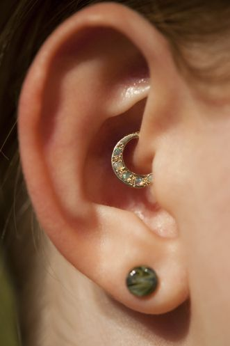 Daith ring. I'm thinking it's this septum clicker from Industrial Strength http://www.bodyartforms.com/productdetails.asp?keywords=PRE-ORDER=Industrial+Strength=11996=10