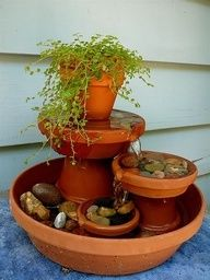 DIY Water Fountain out of terra cotta pots- making this! data-componentType=MODAL_PIN