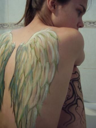 Real Angel Wings Tattoo Designs for Girls Back... wow. that looks more like paint then a tat. That's really sick kinda like it but I'm too classy for a yay that big