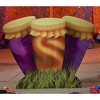 The Conga Drum Standee features three brightly colored drums sitting in a patch of grass. The free-standing Conga drum props measure 3 feet 10 inches high x 4 feet 11 inches wide.