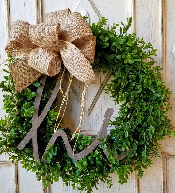 Boxwood Wreath ~ Spring Wreath ~ Farmhouse Decor ~ Gift for Her ~ Housewarming Gift This artificial boxwood wreath has a very realistic look and has a welcoming Hi sign to greet your guest. The burlap bow has 9 loops and 2 streamers to add the perfect charm. It measures about 22 in