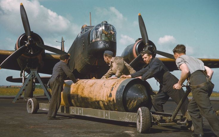 Bomber Command memorial: The RAF bombers of the Second World War - Manhandling a 4000lb bomb on its trolley in front of a Vickers Wellington III of 419 Squadron RCAF, RAF Mildenhall May 1942 Picture: Charles E Brown