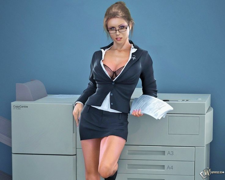 Sexy redhead office worker stretches her pussy with a dildo at her desk