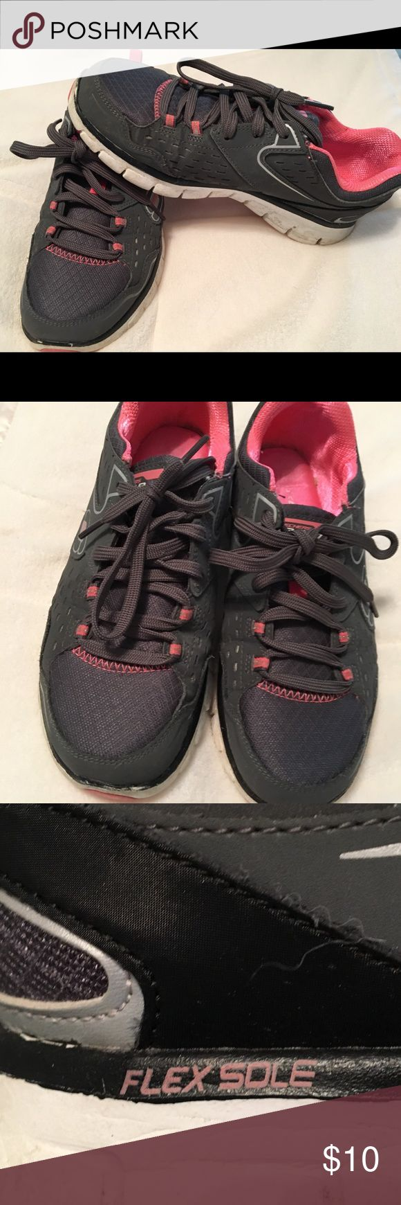 EUC Size 7 memory foam sketcher sneakers Super comfy Sketchers. Dark grey and pink. Only wore twice. I lost 45 pounds and went down a size. Shows very little signs of use. A little dirt on soles as shown. I'm sure with bleach and a toothbrush they will look brand new. Skechers Shoes Sneakers