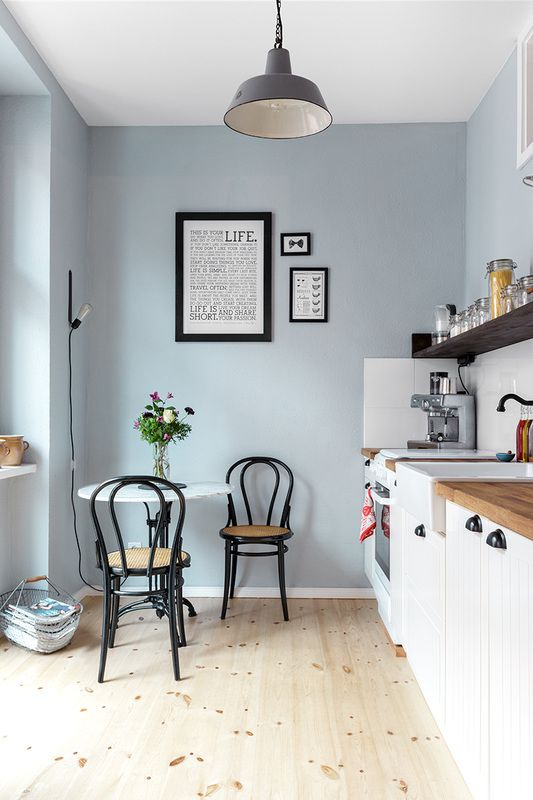 The amazing design of Kathy's own kitchen: We're in love. Light blue walls, black accents. Scandinavian meets French Country meets Industrial style.