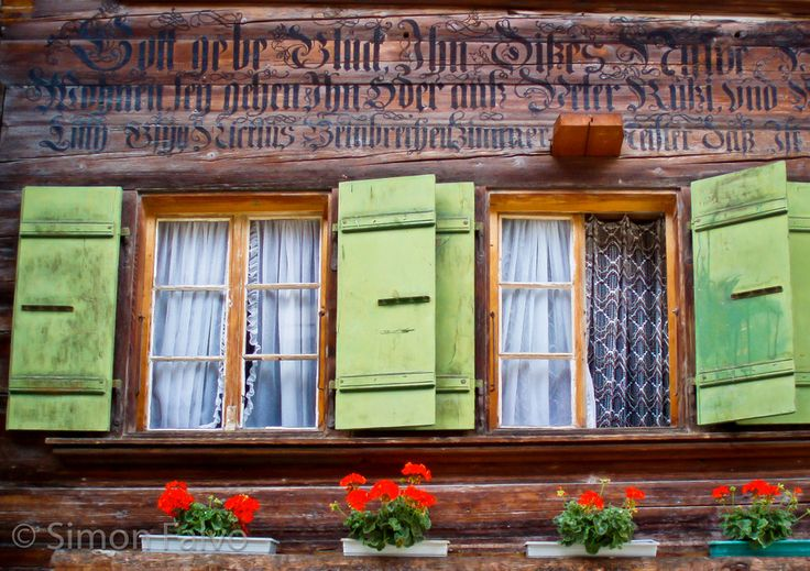 Old Swiss Chalet, green shutters, write Bible Verses in old German font on house exterior