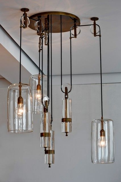 By Alison Berger, master glassblower The Counterweight Chandelier, part of Ms. Berger's 2014 collection of lighting for chic Chicago-based retailer Holly Hunt. The custom-made, sculptural assembly uses pulleys to suspend an intricate system of handblown crystal light pendants balanced by crystal-and-bronze weights. Pull on the weights to raise or lower the pendants and adjust the height at which the light shines.