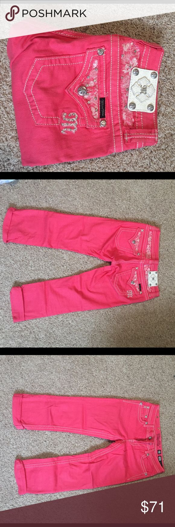 Salmon colored Miss me Capris In the picture these look very pink, but they are more of a salmon color. I am selling these because I never wear them. These are really really cute. The waist is a size 27 and they are capris. Really great for summer and spring! In very good condition! Miss Me Jeans Ankle & Cropped
