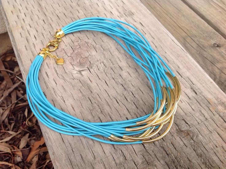 Turquoise and gold leather necklace.