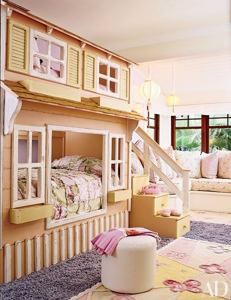 For a family home in Hawaii, architecture firm Ike Kligerman Barkley and designers Ron Wilson and Joe Guidera created the ultimate girl's room. The space features a playhouse-like structure that contains bunk beds and a staircase with storage drawers built into the steps. | archdigest.com