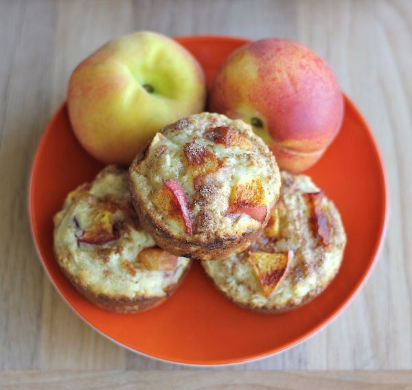 Peach Oatmeal Muffins - Wonderfully light and healthy, these cinnamon sugar crusted muffins are the perfect start to your mornings!