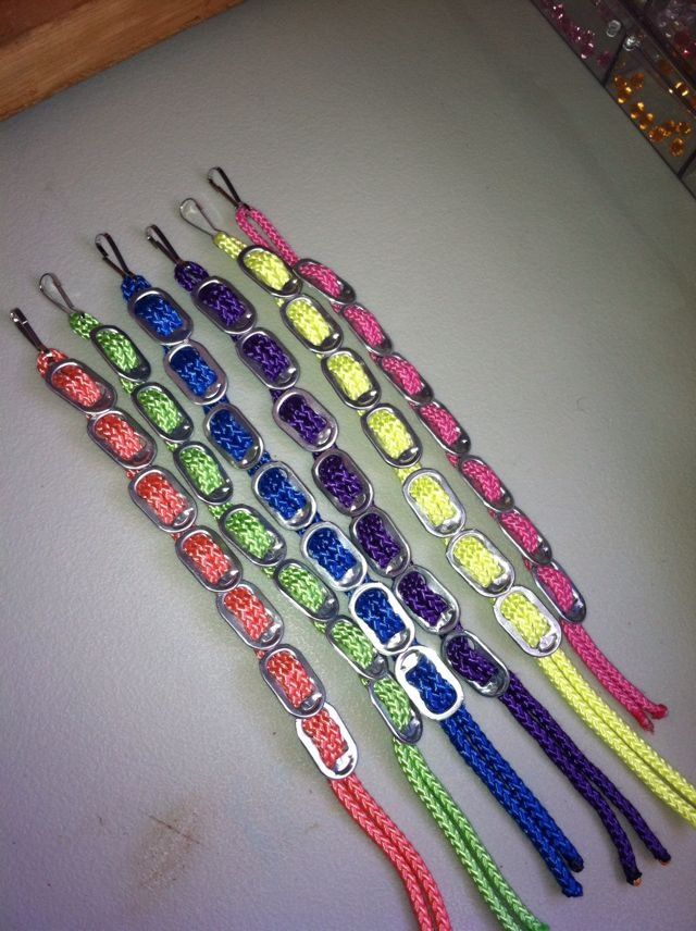 Recycled soda can pop tops with color cord made into CAUSE bracelets. Not beading, but cool none the less..