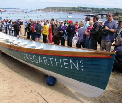 The official launch of the new Scilly gig 'Tregarthens' on Town Beach, St Marys,  April 2012. Blessed by both the Anglican  and Methodist Ministers and launched by  the Lord Lieutanant of Cornwall, she was  built by craftsman shipwright Peter Hicks  in his workshop at Porthloo, St. Marys.  In her debut year, she was rowed to second place by a St. Marys gig crew in the Women's Championship. Well done all round!