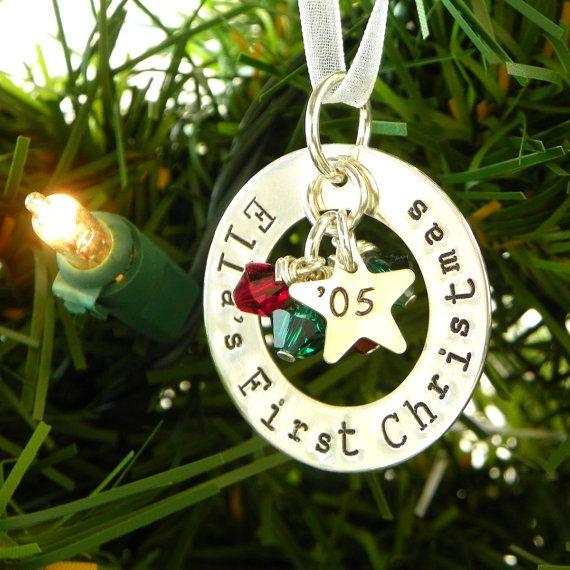 What a beautiful way to celebrate a First Christmas and create a treasured family heirloom as well! This sterling silver 1-1/4 diameter washer is hand stamped with your phrase (up to 25 characters including spaces in this font). A sweet little sterling star will be stamped with the year and hang in the center with six 6mm genuine Swarovski crystals (3 red and 3 green, or 6 clear). Your finished ornament hangs from a sweet, white organdy ribbon. Each ornament comes packed in a sweet p...