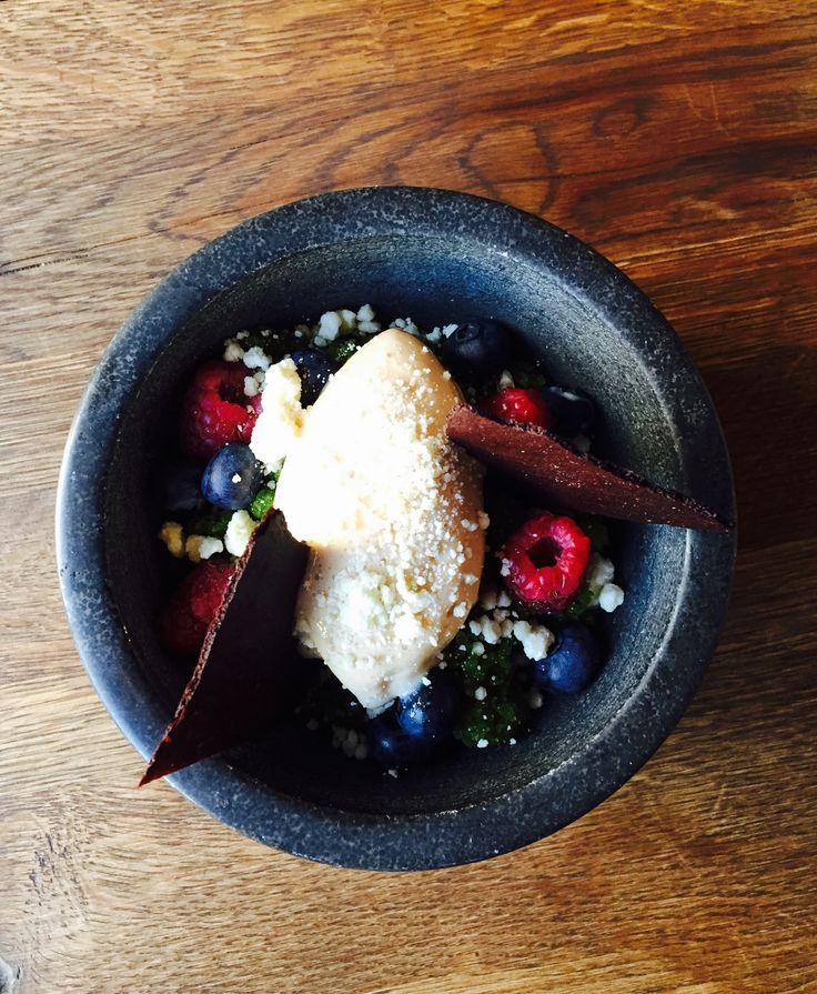 Parsley granita with fresh berries, white chocolate crumbs and caramel sorbet.