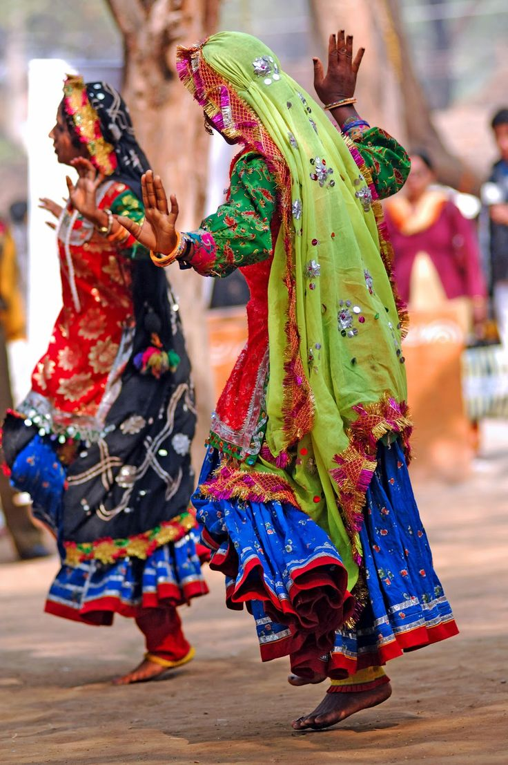 joyful dancers in colorful outfits...