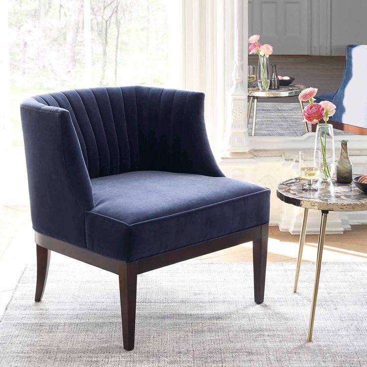 """Full of vintage charm with a channeled back and delicately tapered legs. Pair two for the perfect conversation area. 28"""" Wide, 31"""" Deep, 31"""" TallFull Dimensio"""