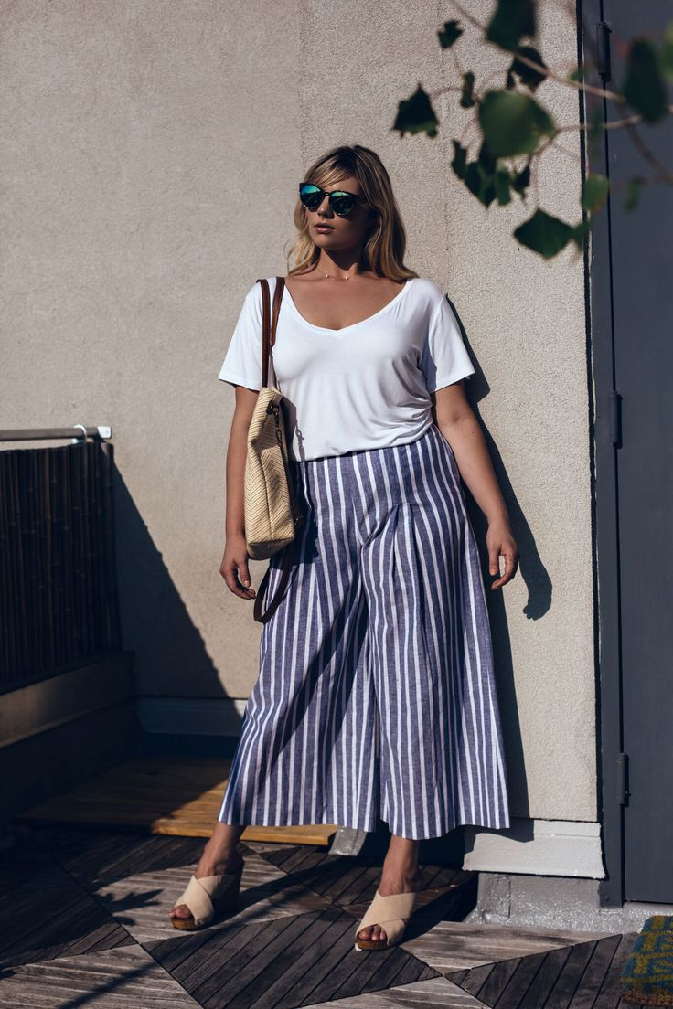 Balance statement pants with an understated tee, an open neckline, and neutral accessories. Also check out our Hampton's Striped Palazzo Pants by Shegul: http://www.heygorgeous.com/collections/shegul/products/shegul-hamptons-striped-palazzo-pants