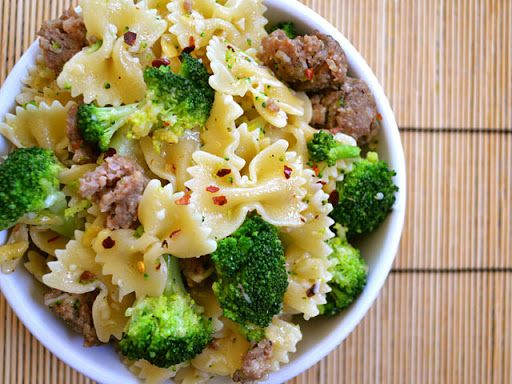 Spicy Sausage & Broccoli Pasta With Olive Oil, Garlic, Crushed Red Pepper, Italian Sausage, Frozen Broccoli Florets, Bow-tie Pasta, Smoked Gouda, Shredded Italian Cheese, Salt, Pepper
