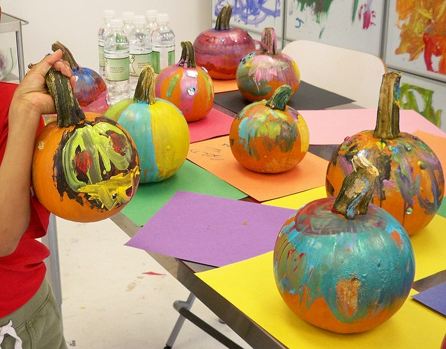 Pumpkin painting makes a fun activity for a fall art party.