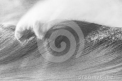 Ocean wave crashing curling lip in black white vintage contrast