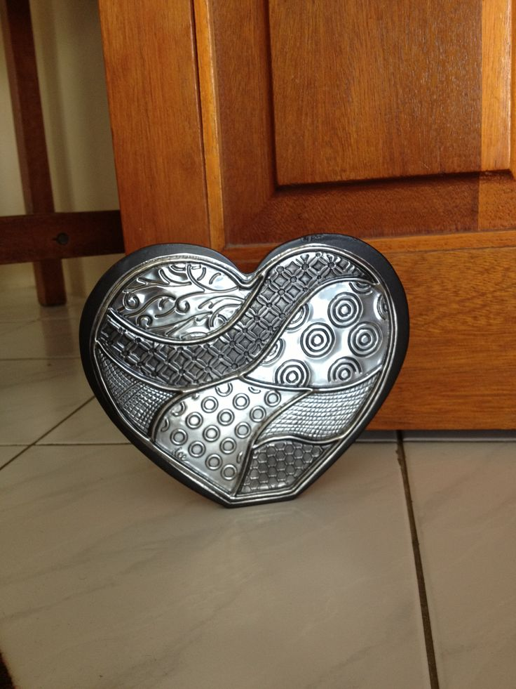 Wooden heart doorstop with embossed pewter art  www.thepewterroom.co.za
