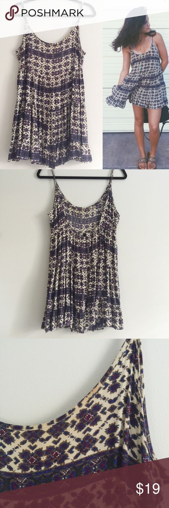 "Purple Bohemian Print Jada Dress Brandy Melville Jada dress in the purple bohemian print as seen on MTV Teen Wolf actress Victoria Moroles. Has adjustable straps that vary the length from 25"" to 30"". Tiered babydoll style with a purple and tan tribal print. Sold out online and in Brandy stores. Makeup stain pictured in the third photo. Brandy Melville Dresses Mini"