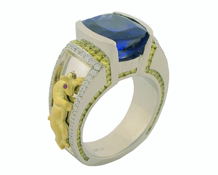 Are you a matador at heart? If so, you'll love this Tanzanite gents ring with yellow diamonds by Mark Schneider.