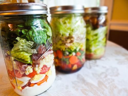Salad in a jar! It's super convenient, especially if you're packing a lunch to take with you to work or school. With this method you get your greens, your delicious toppings, and your dressing all in ONE easy container.