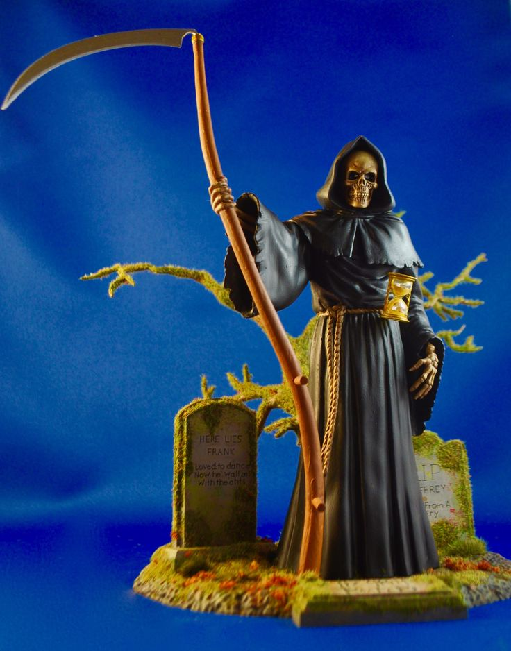 Grim Reaper kit from Moebius models with base.  Lots of artificial greenery used on base to create mossy graveyard look.  Photo and build-up by Stan G. Hyde.