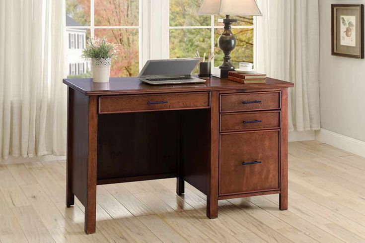 Desk, Red Brown Finish   	Transitional style single pedestal desk  	Features three drawers, file cabinet, and power outlet  	File cabinet can hold both legal and letter size files  	Available in honey and red brown  kids furniture