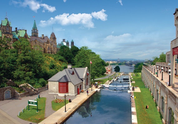 A beautiful view of the Rideau Canal locks and the Bytown Museum, Ottawa. For more information on capital sites and Canadian heritage visit http://www.ottawatourism.ca/en/visitors/what-to-do/capital-heritage