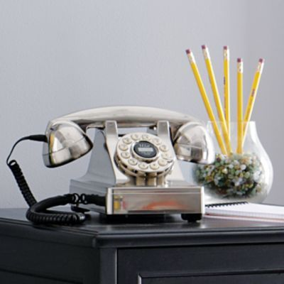 Retro Desk Phone $69   Also in black & red    Our classic Retro Desk Phone combines vintage 1940s character with the modern conveniences of push-button dialing. Adds timeless style and attitude to any room. Features many contemporary amenities.