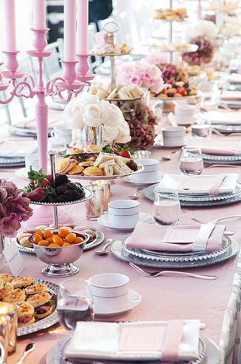 Afternoon tea doesn't have to be stuffy. Take a cue from the Mad Hatter and use tiers of finger sandwiches and sweets as edible centerpieces. The pink candle holder is gorgeous!