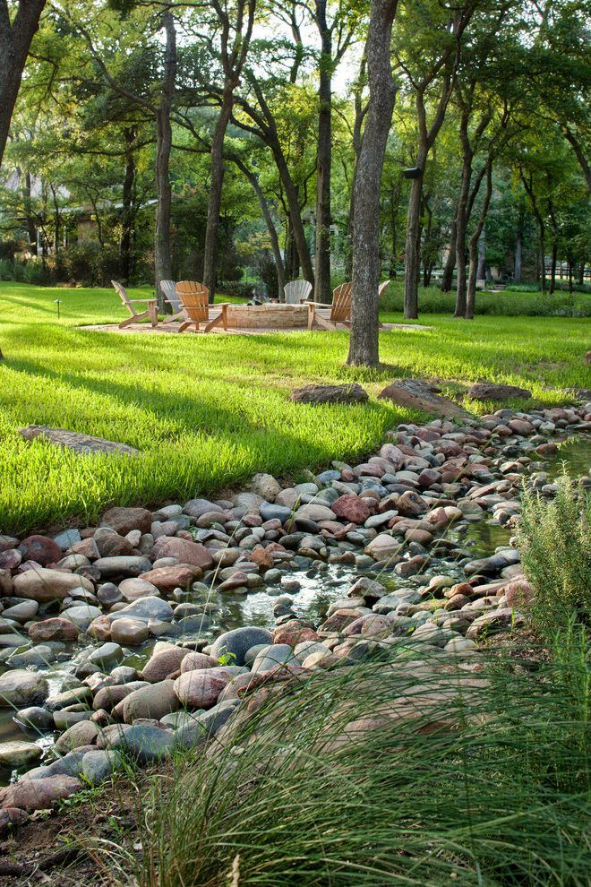 diy dry creek beds landscape mediterranean with boulders traditional adirondack chairs