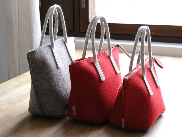 Designing a lunch bag is in progress. The middle in the photo is the 4th prototype of a lunch bag with laminated felt.