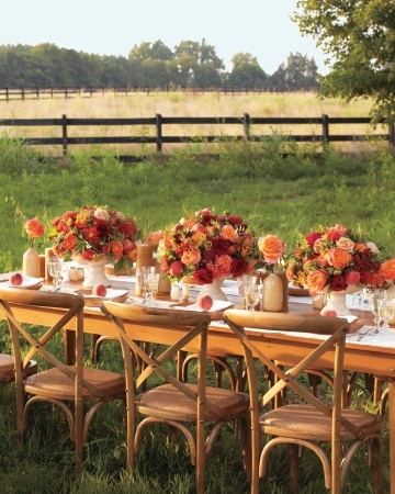 "Here, clusters of garden roses, viburnum berries, and dahlias fit right in with an outdoor setting. But grass is not required: ""By mixing in pieces made from natural materials, like the wooden table and stoneware salt and pepper shakers, you can bring a country feel to any venue, inside or out,"" says Cossette."