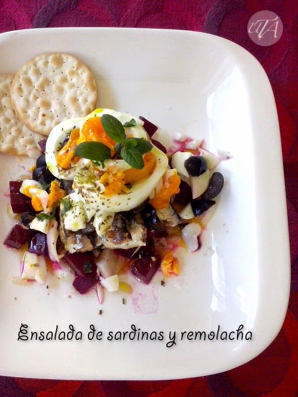 Salad with sardines, beetroot, egg and black olives