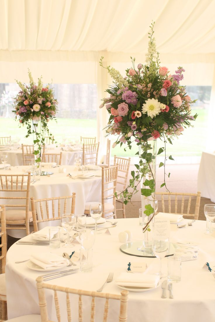 Tall loose style arrangements with larkspur roses dahlia
