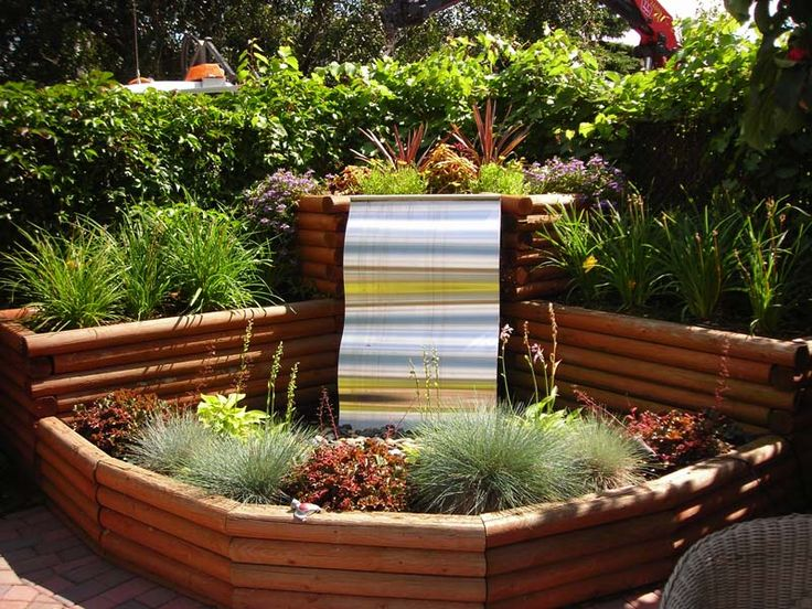 Tropical landscape designs ribbon of grass stainless for Fountain grass landscaping ideas