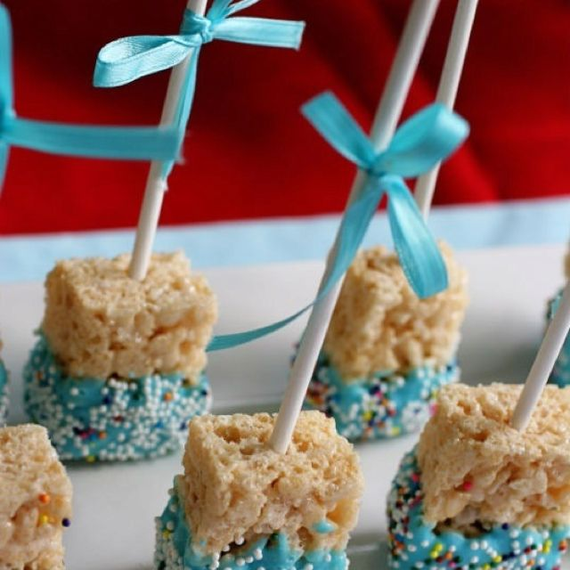 Mini rice crispie treats dipped in candy melts to match the party theme.