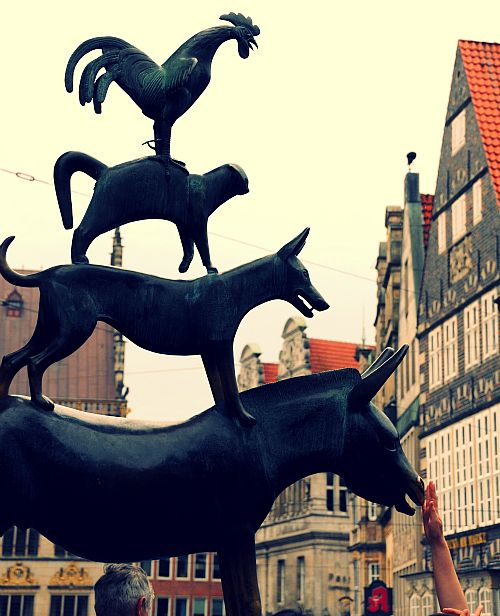 Sculpture of Aesop's fabel, the Bremen Town Musicians in Bremen, Germany - If you touch the donkey's nose and hoofs, you will come back to their city.