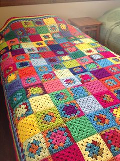 I did a basic 4 row granny square pattern, joining the squares with a slip stitch along the back. Then, I did a row of granny stitch in each color around the entire blanket.