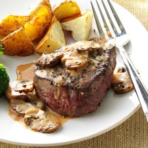 Tenderloin Steak Diane4 beef tenderloin steaks (6 ounces each)  	1 teaspoon steak seasoning  	2 tablespoons butter  	1 cup sliced fresh mushrooms  	1/2 cup reduced-sodium beef broth  	1/4 cup heavy whipping cream  	1 tablespoon steak sauce  	1 teaspoon garlic salt with parsley  	1 teaspoon minced chives