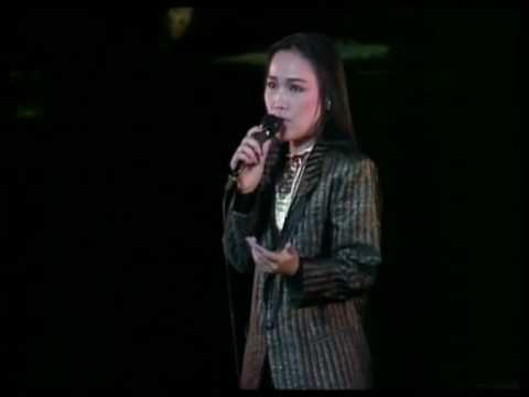 五輪真弓 (Mayumi Itsuwa) - 雨の中の二人 - https://www.youtube.com/watch?v=M0BqShOLjEI
