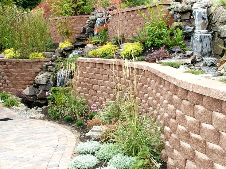 retaining wall with waterfall into planter landscaping on wall blocks id=12021