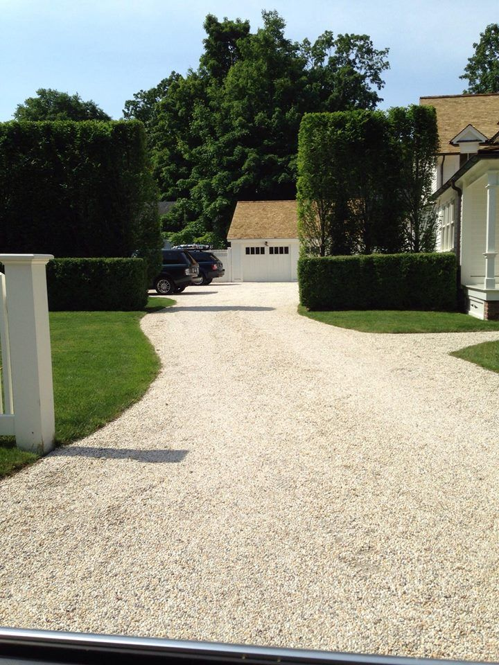 love the entrance, gravel drive and hedges...
