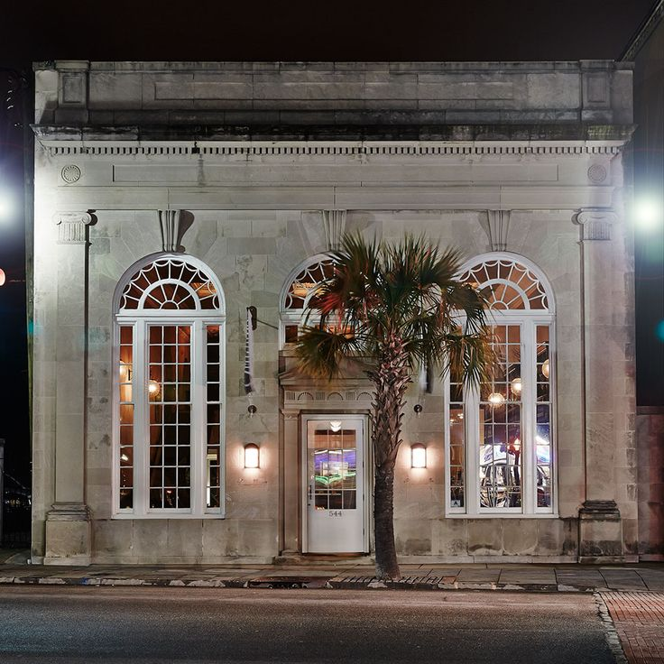 The Ordinary oyster restaurant in Charleston SC at night.